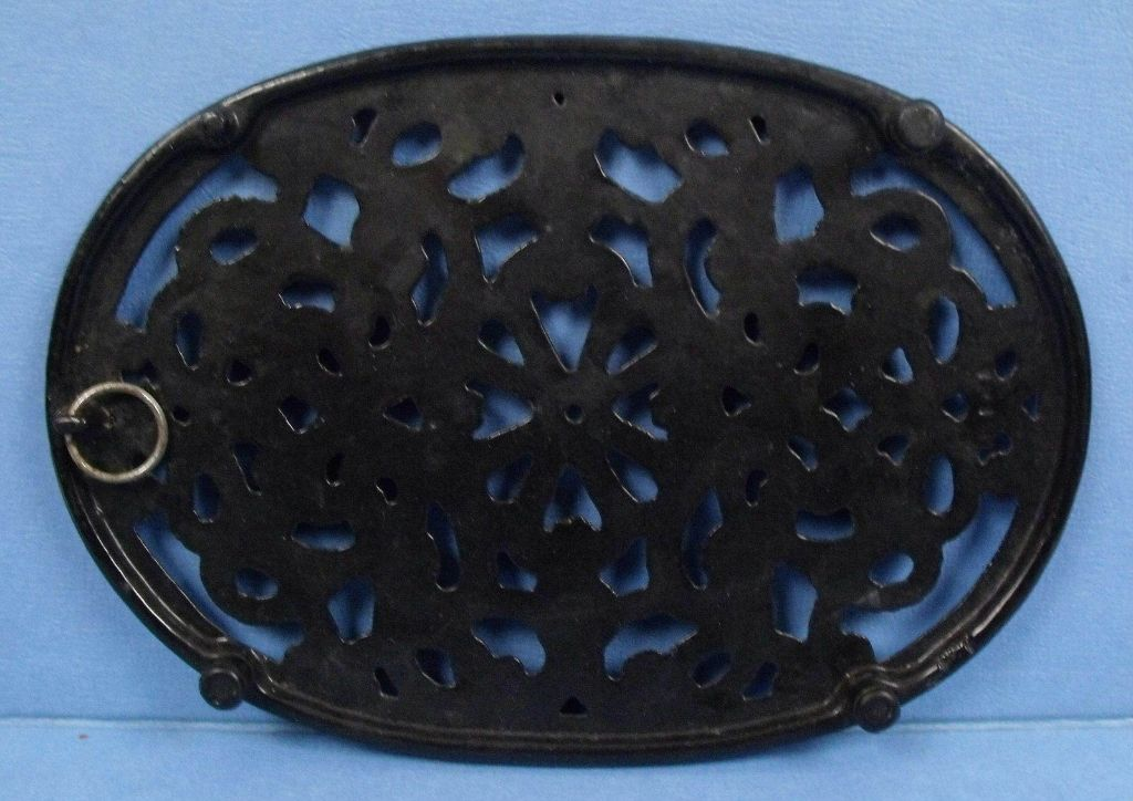 oval shaped cast iron trivet mary and tom 39 s kitchen. Black Bedroom Furniture Sets. Home Design Ideas